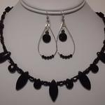 Black beads and crystals set.