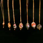 Assorted pendants; cloisonne, beads and minerals.