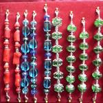 Mixed large beads with silver; dyed red coral,blue glass,green glass.