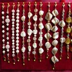 Gold to white spectrum with mixed gold; gold glass disks, shell, mother of pearl, crystals.